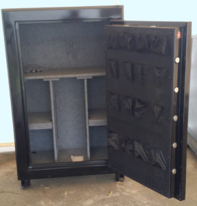"Original Gun Safe 6040 One Hour Fire Rating High Gloss Black Finish with Dial Lock. Door Open. Dims Exterior: H59"" x W39"" x D24"""